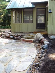 Dry river bed located next to patio