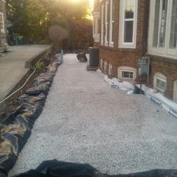 Large permeable patio base in preparation of construction.