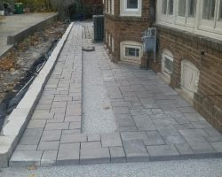 richcliff patio town hall paver inlay and lannon sawed retaining wall - Patio Town