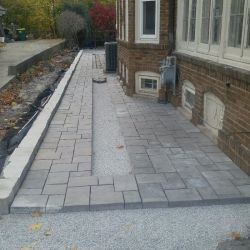 Richcliff patio, Town Hall paver inlay and Lannon sawed retaining wall.
