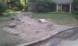Boulders, stone work and decorative stone elements in a dry riverbed