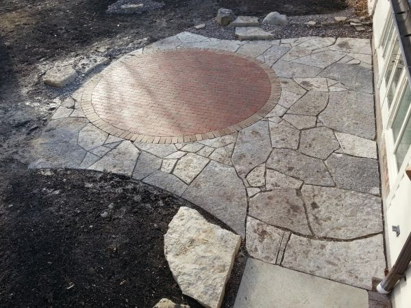 Lannon flagstone patio, brick inlay natural shape