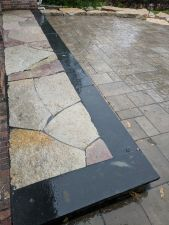 Menomonee Falls WI Black Coping Flagstone Inlay Chilton Accents